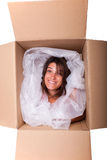 Funny package. Woman face inside a cardboard box smiling Royalty Free Stock Photography
