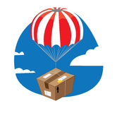 Funny package with parachute landing Royalty Free Stock Photography
