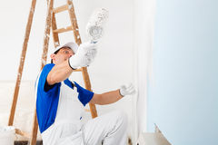 Funny painter with paint roller Royalty Free Stock Photos
