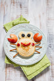 Funny pancake crab with apple. Funny breakfast for child. Pancake crab with apple Royalty Free Stock Photography
