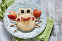 Funny pancake crab with apple. Royalty Free Stock Image