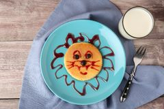 Funny pancake for kids breakfast,. On wooden background Royalty Free Stock Image