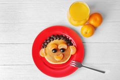 Funny pancake for kids breakfast,. On wooden background Stock Photos