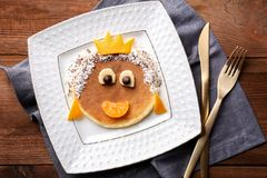 Funny pancake for kids breakfast,. On wooden background Royalty Free Stock Images