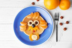 Funny pancake for kids breakfast. On wooden background Stock Photography