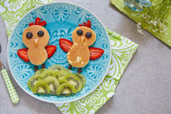 Funny pancakes for kids breakfast. Funny chickens pancakes with berries for kids breakfast royalty free stock photography
