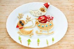 Funny pancakes Santa Claus and reindeer ride in a sleigh , creat Stock Image