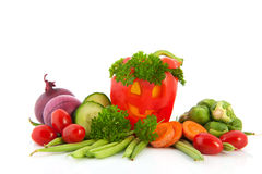 Funny paprika with vegetables Royalty Free Stock Photo