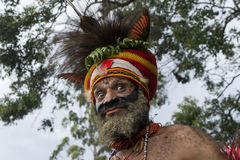 Funny papuan man in Goroka show. A funny papuan participant to the famous Goroka show looking at the camera Stock Photography