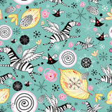 Funny pattern with zebras. Seamless colorful pattern with zebras on a green background with snowflakes and leaves Royalty Free Stock Images