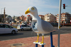 Funny payphone in the form of a seagull.  stock photo
