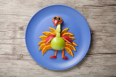 Funny peacock made of fruits Stock Image