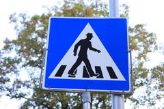 Funny pedestrian crossing sign in hat stock images