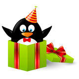 Funny penguin. In gift box Stock Photography