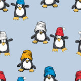 The funny penguins in the caps Royalty Free Stock Image