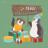 Funny penguins friends celebrating Christmas Royalty Free Stock Images