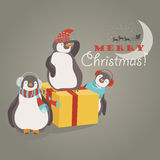 Funny penguins friends celebrating Christmas Royalty Free Stock Image