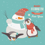 Funny penguins with snowman celebrating Christmas. Vector illustration Royalty Free Stock Photo