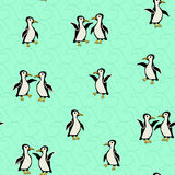 Funny penguins on a turquoise background with waves Royalty Free Stock Photo