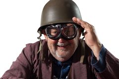Funny pensioner with helmet and pilot goggles saluting Royalty Free Stock Image