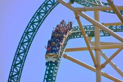 Funny people, descending to 60 miles per hour in terrific Cheetah Hunt Rollercoaster at Bush Gard. Tampa, Florida. October 25, 2018 Funny people, descending to stock photos