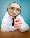 Funny people with a magnifier. In a hand stock photo