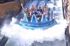 Funny people raising hands, having fun Infinity Falls at Seaworld Theme Park. Orlando, Florida. October 19, 2018 Funny people raising hands, having fun Infinity royalty free stock photos