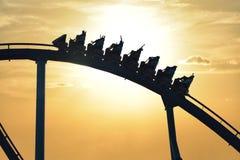 Funny people riding Mako Rollercoaster at Seaworld on beautiful sunset background. Orlando, Florida. September 21, 2018. Funny people riding Mako Rollercoaster royalty free stock photo