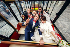 Funny people sit in the tourist bus together with newlyweds.  royalty free stock photo
