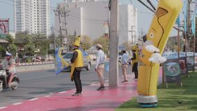 Funny Peoples in Costumes Try to Attract Passing Cars with Advertisement