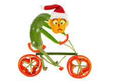 Funny pepper on a bicycle. Happy New Year Stock Photography