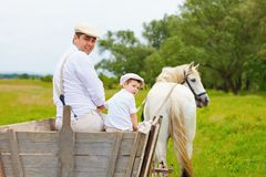 Funny photo of farmer family and horse looking back Royalty Free Stock Photos