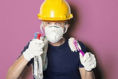 Funny photo of male ready to clean the house / dishes in protective clothing.  Royalty Free Stock Photos