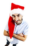 Funny photo of smiley man in santa claus hat Royalty Free Stock Image
