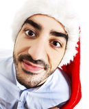 Funny photo of smiley man in santa claus hat Royalty Free Stock Photos