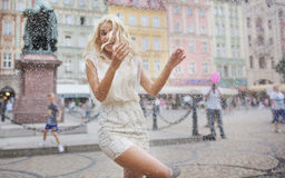 Funny photo of the wet blond lady Stock Photography