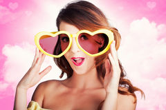Love Is Blind. Woman Wearing Heart Shape Glasses Stock Images