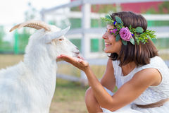 Funny picture a beautiful young girl farmer with a wreath on her Royalty Free Stock Photos