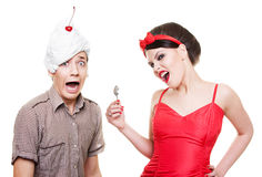 Funny picture of couple. Funny picture of man with dessert on his head and woman with spoon Stock Image