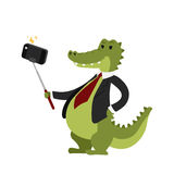Funny picture crocodile photographer mamal person take selfie stick in his hand and cute animal taking a selfie together Stock Image
