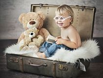 A funny picture of little boy in suitcase Stock Photography