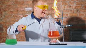 A scientist conducts an experiment and his hand lights up stock photo