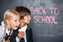 Funny picture of school boy and girl with Stock Images