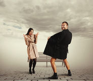 Funny picture of woman and exhibitionist Royalty Free Stock Photography