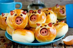 Funny pig buns stuffed with sausage stock photo