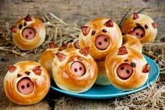 Funny pig buns stuffed with sausage. Closeup stock photos