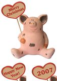 Funny pig with heart. Merry Christmas and variants 2007, Happy New Year - isolated Stock Images