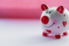 Funny piggy bank and on pink background. Savings concept. Funny piggy bank and on pink background Royalty Free Stock Image
