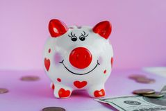 Funny piggy bank and on pink background. Savings concept. Funny piggy bank and on pink background Stock Image