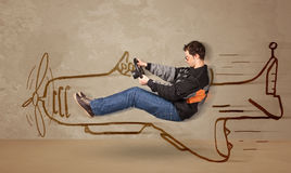 Funny pilot driving a hand drawn airplane on the wall Stock Image